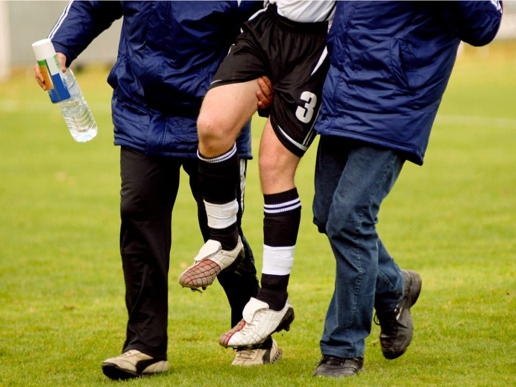 Injured athlete being carried off field