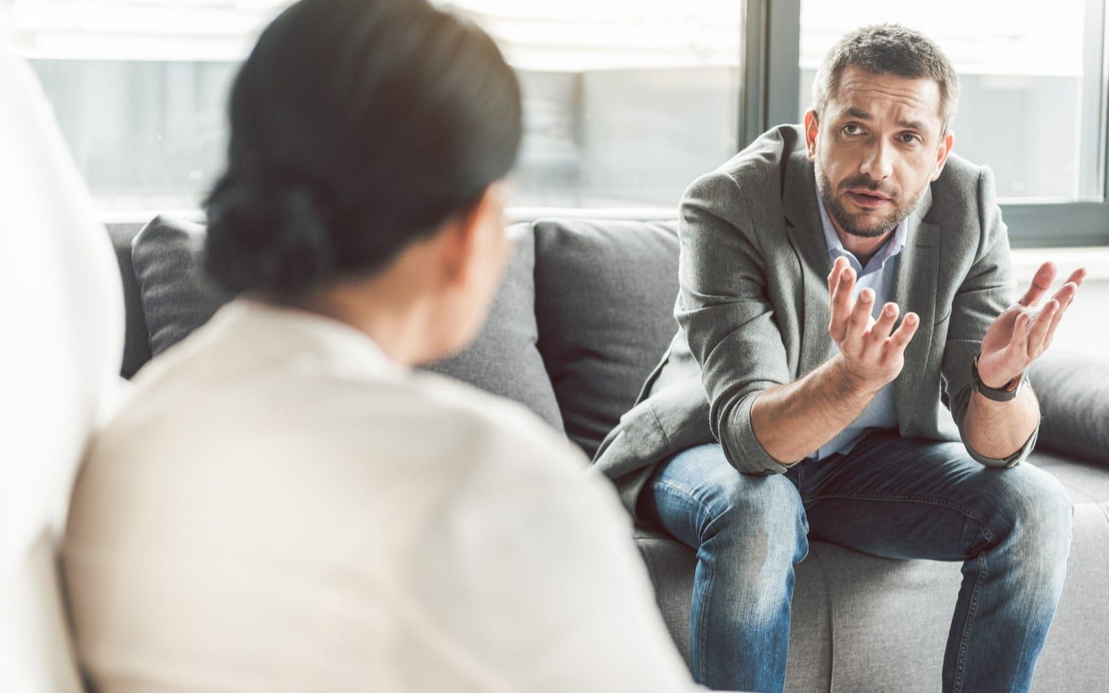 Man speaking to doctor about sensitive subjects